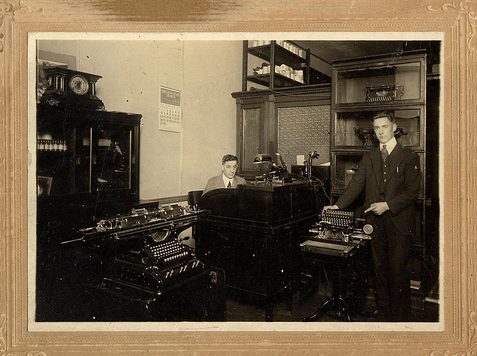 Dad w typewriters 16 years old 1921.jpg